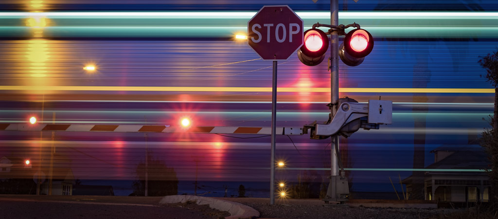 Railroad crossing with a passing train