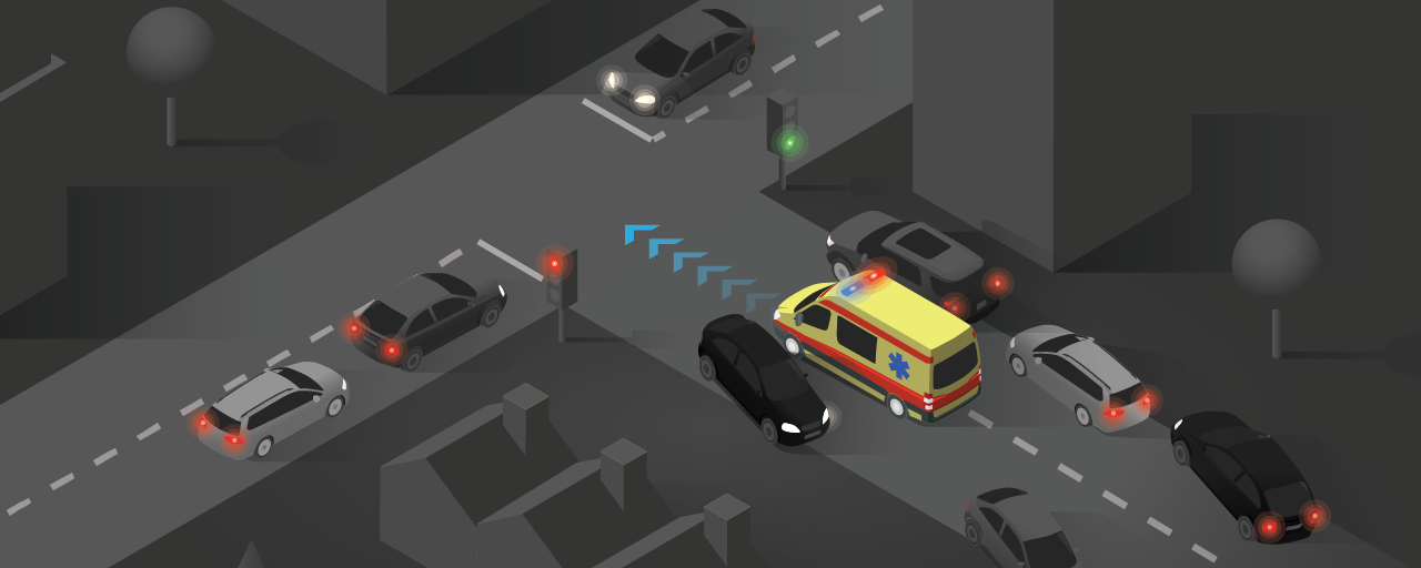 Emergency vehicle driving through a corridor formed by vehicles towards a traffic accident at an intersection